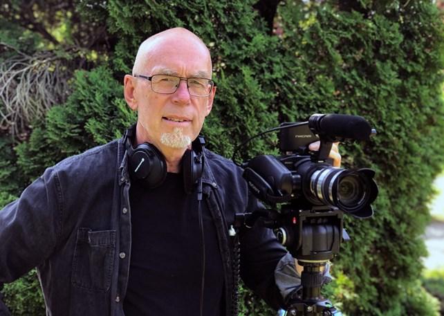 Mann med kamera